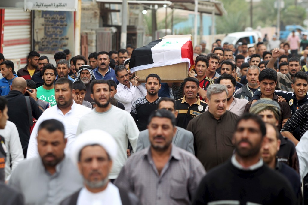 Mourners attend the funeral of a victim killed by a suicide bombing at a soccer field in Iskandariya, Iraq March 26, 2016. Alaa Al-Marjani/Reuters
