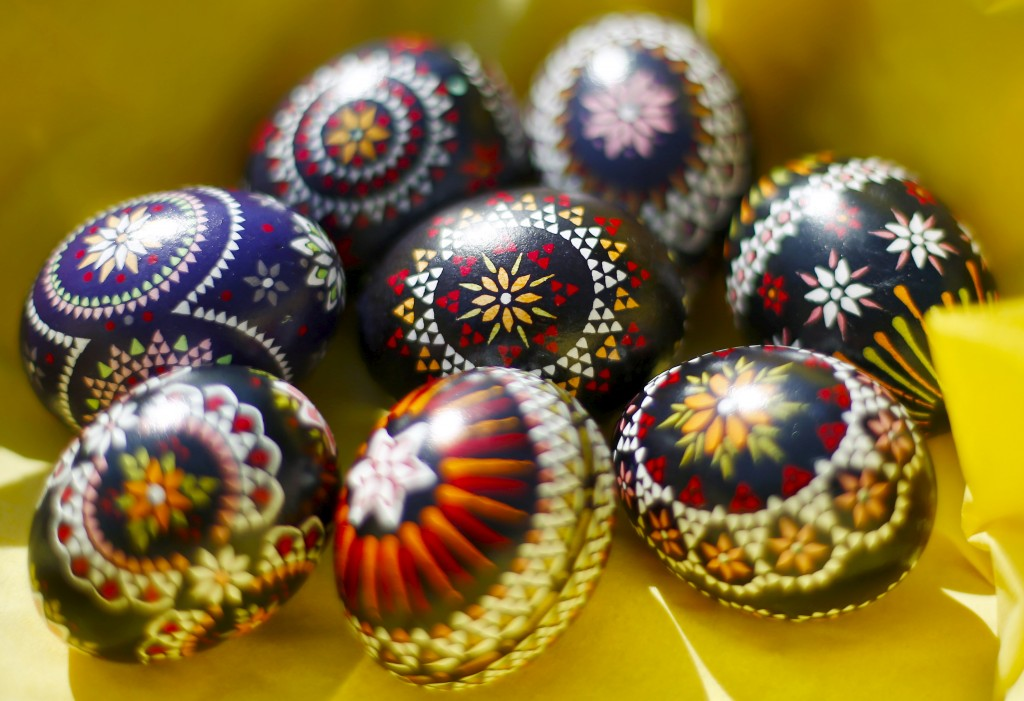 Easter eggs adorned in traditional Sorbian style are seen in Schleife, about 160 kilometers (99.4 miles) south-east of Berlin, Germany, March 27, 2016. A tiny Slavic minority in Germany is keeping alive a long and intricate tradition of hand-painting Easter eggs with the help of feathers and wax. REUTERS/Hannibal Hanschke  - RTSCE4J