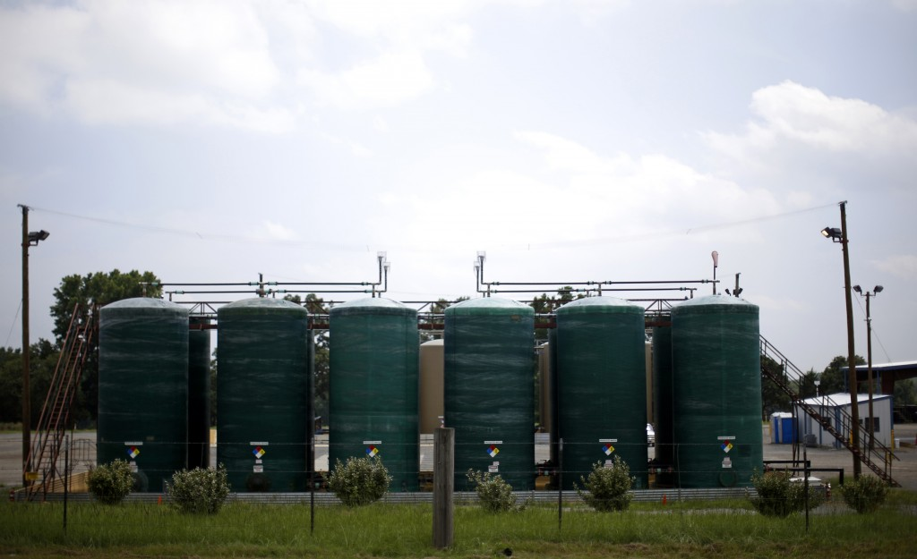 The treatment tanks at the SRE salt water disposal well are seen in Guy, Arkansas, August 6, 2013.  Photo by Jim Young/REUTERS