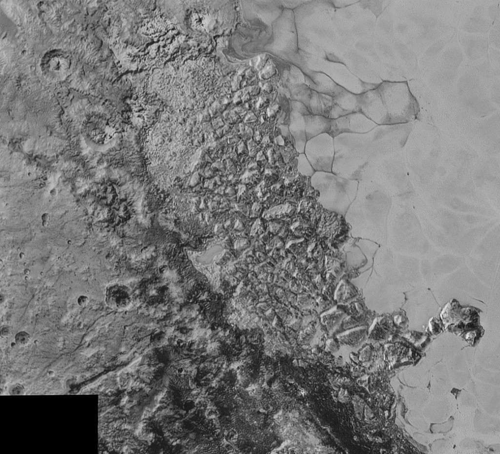 Pluto from NASA's New Horizons spacecraft is a large region of jumbled, broken terrain on the northwestern edge of the vast, icy plain informally called Sputnik Planum. Photo by NASA/Johns Hopkins University Applied Physics Laboratory/Southwest Research Institute.