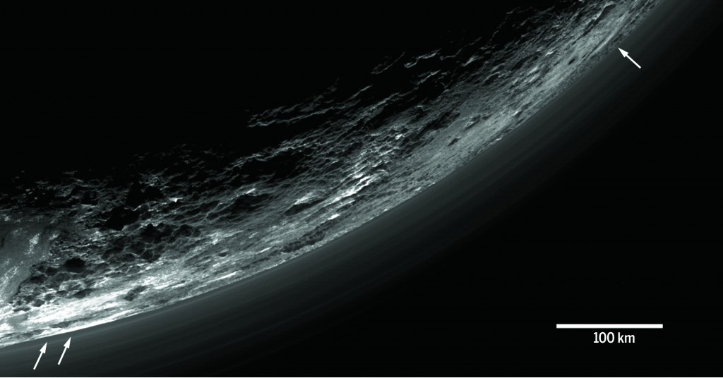 """Haze layers above Pluto taken by the Ralph/Multispectral Visible Imaging Camera (MVIC) on NASA's New Horizons spacecraft. About 20 haze layers are seen; the layers have been found to typically extend horizontally over hundreds of kilometers, but are not strictly parallel to the surface."""" Photo by G.R. Gladstone et al., Science (2016)"""