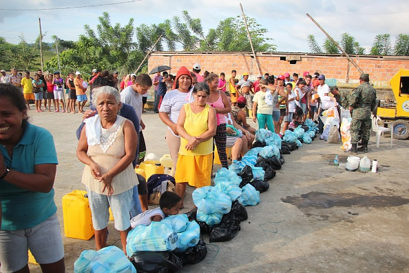 People are seen at a camp by the United Nations (UN) after thousands of people were made homeless following the earthquakes in Pedernales, Ecuador on April 26, 2016. UN, Red Cross and aid organizations from many different nations began distributing aid accompanied by police on the northern shores of Ecuador, which were the worst hit by the earthquake. The inhabitants of Pedernales, where 168 people lost their lives and 2,455 were made homeless, struggle with life in UN camps or makeshift huts they have erected themselves. Enes Duran/Anadolu Agency/Getty Images