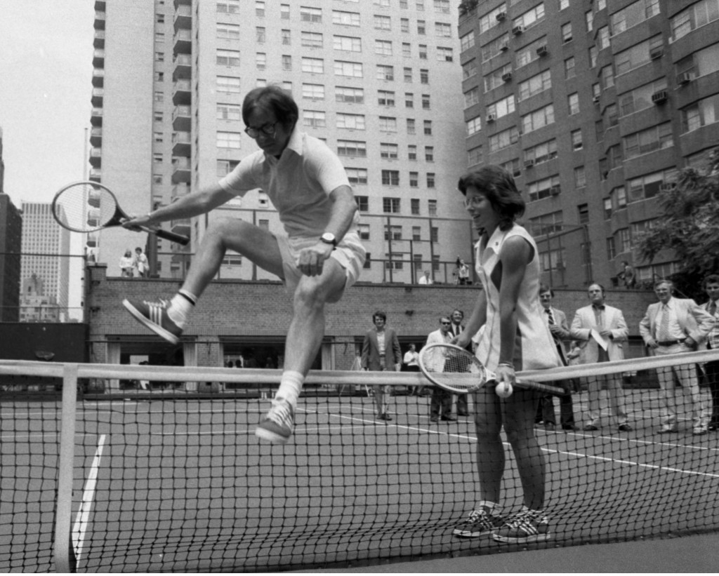 Photo of Billie Jean King, then 29, and 55-year-old Bobby Riggs, as he hops over net at a tennis court in New York. Photo by  Jim Garrett/NY Daily News via Getty Images