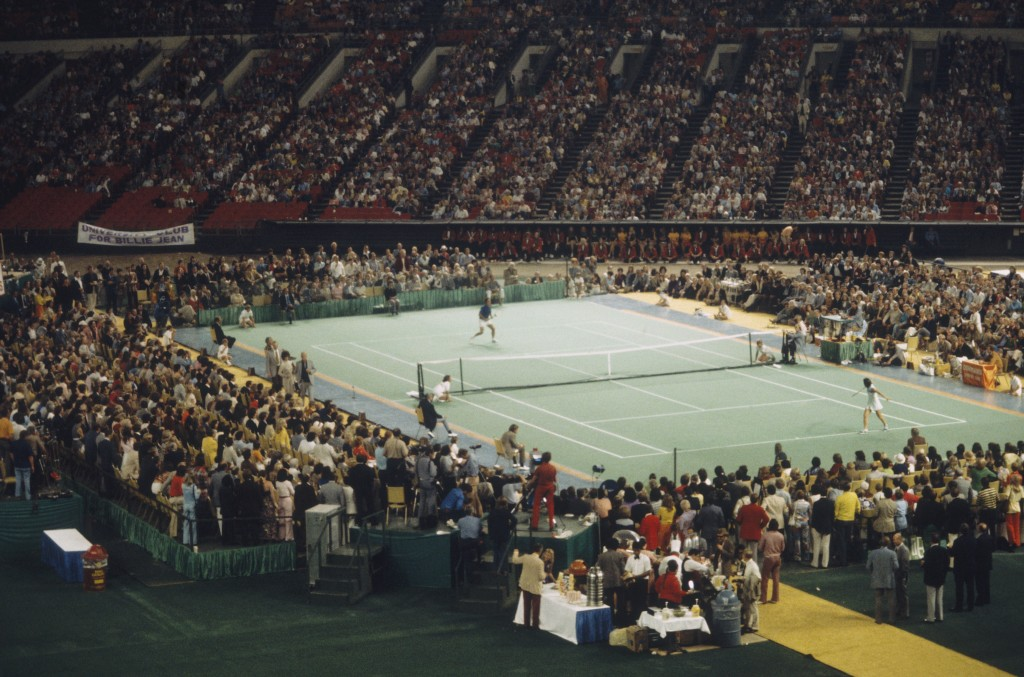 "Billie Jean King faces off Bobby Riggs in front of 30,000 spectators at the Houston Astrodome in Texas on September 20, 1973. King defeated Riggs in three straight sets 6-4, 6-3, and 6-3, winning the  ""Battle of the Sexes"" match. Photo by Focus on Sport/Getty Images"