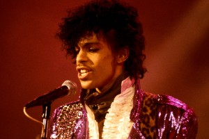 """Prince performing on stage during the """"Purple Rain"""" tour. Photo by Ebet Roberts/Redferns"""