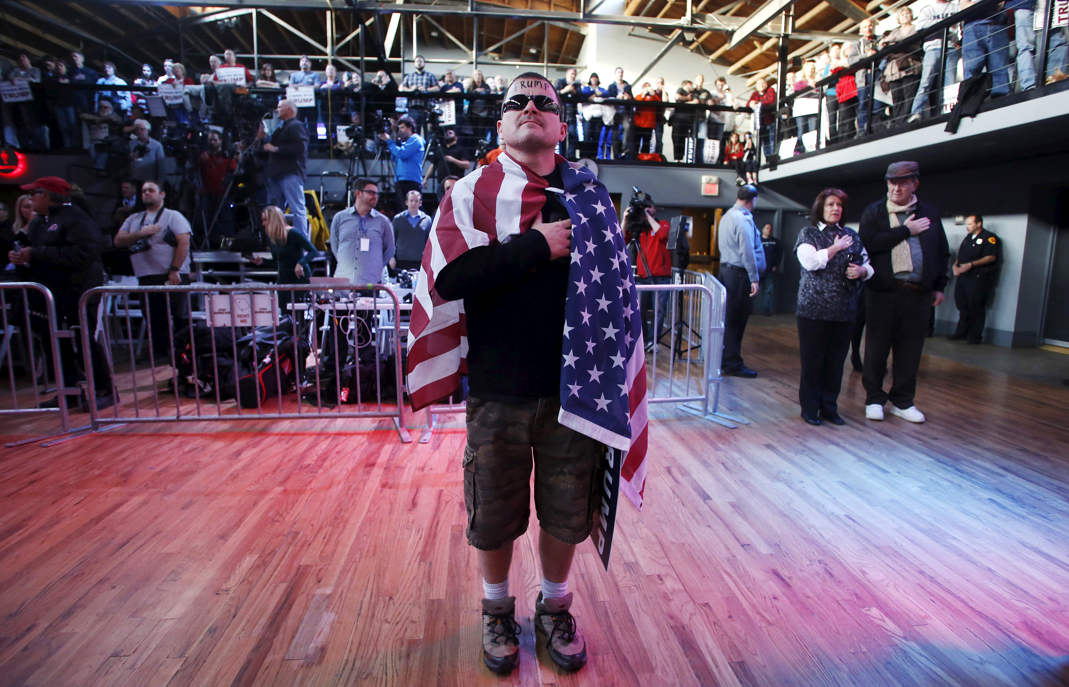 Supporter Jansen Tropf wears an American flag at a campaign rally for Republican U.S. presidential candidate Donald Trump in Salt Lake City, Utah March 18, 2016. Photo by Jim Urquhart/Reuters