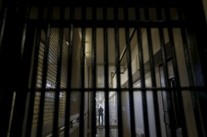 A guard stands behind bars at the Adjustment Center during a media tour of California's Death Row at San Quentin State Prison in San Quentin, California