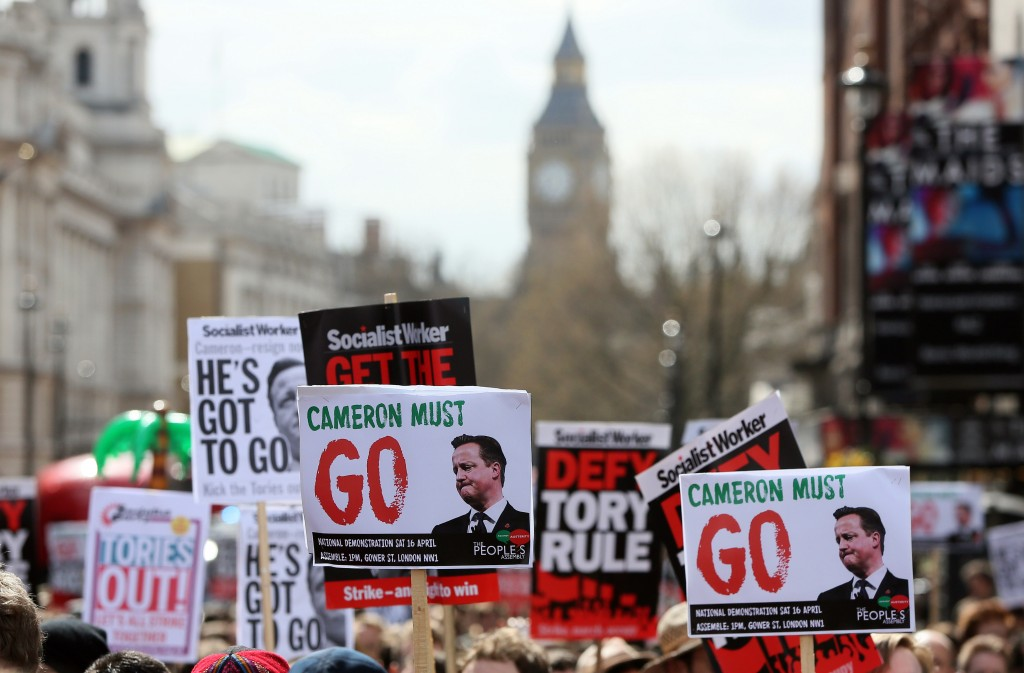 Demonstrators hold placards during a protest outside Downing Street in Whitehall, central London, Britain April 9, 2016. British Prime Minister David Cameron said on Saturday he should have handled scrutiny of his family's tax arrangements better and promised to learn the lessons after days of negative media coverage and calls for his resignation  REUTERS/Neil Hall - RTX296TB