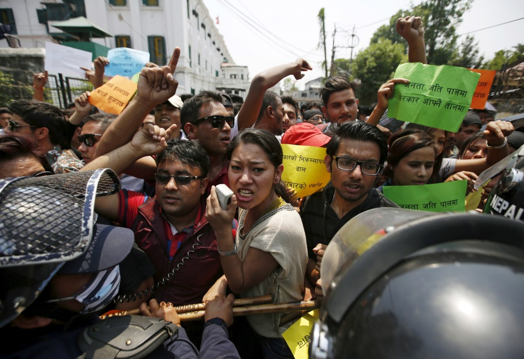 Nepalese police personnel try to stop protesters marching towards the Singha Durbar office complex that houses the Prime Minister's office and other ministries, during a demonstration against the government for the delay on reconstruction and relief during the first anniversary of the 2015 earthquakes in Kathmandu, Nepal, April 24, 2016. Navesh Chitrakar/Reuters
