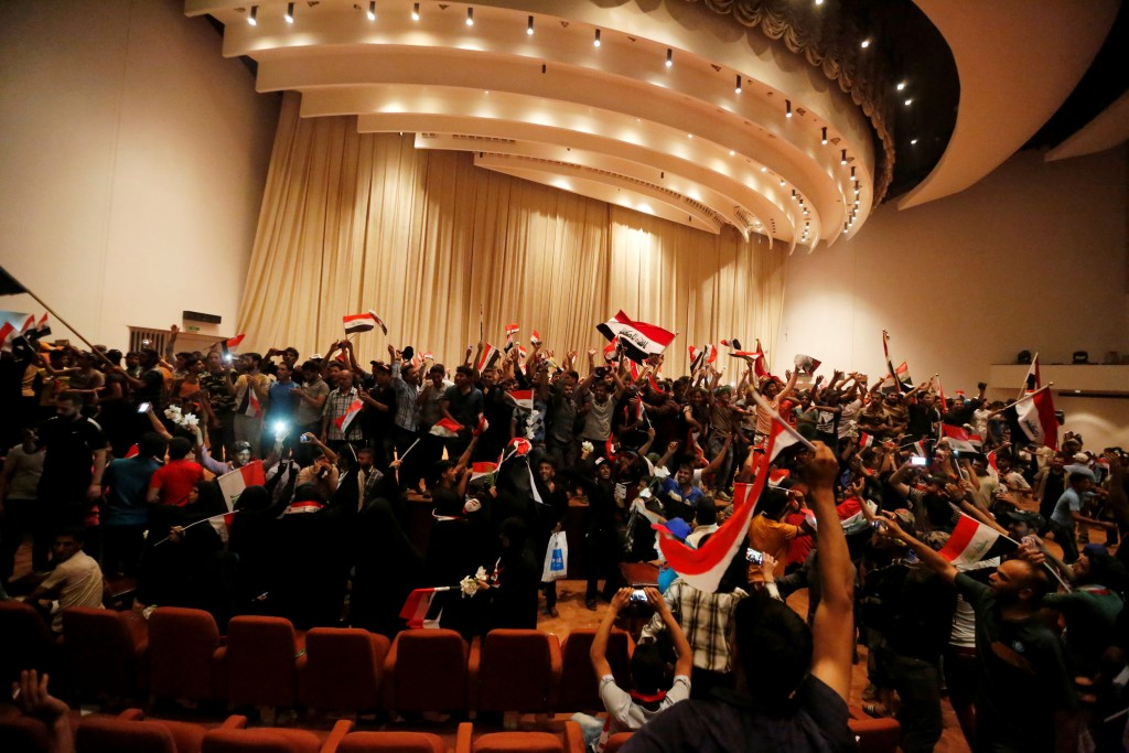 Followers of Iraq's Shi'ite cleric Moqtada al-Sadr are seen in the parliament building as they storm Baghdad's Green Zone after lawmakers failed to convene for a vote on overhauling the government, in Iraq April 30, 2016. REUTERS/Ahmed Saad - RTX2C8Y6