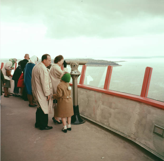 Visitors on Space Needle observation deck, 1962. Photo by by George Gulacsik, image courtesy of the Seattle Public Library