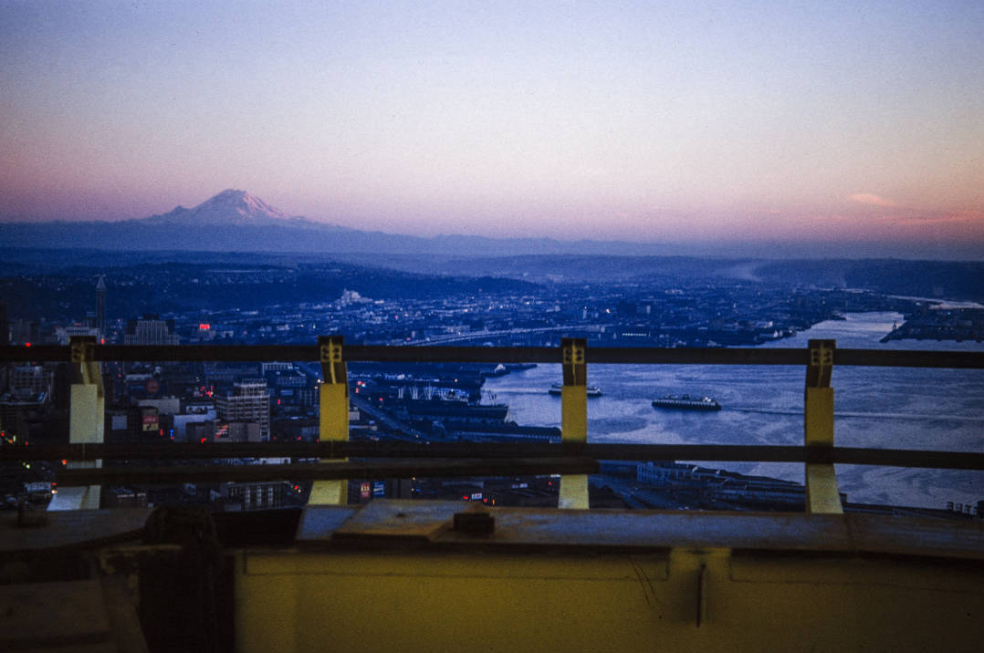 View of Mount Rainier from the Space Needle, ca. November 1961. Workers preparing ground for Space Needle foundation, ca. April 1961. Photo by by George Gulacsik, image courtesy of the Seattle Public Library