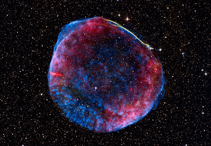 A new star, likely the brightest supernova in recorded human history, lit up planet Earth's sky in the year 1006 AD. The expanding debris cloud from the stellar explosion, found in the southerly constellation of Lupus, still puts on a cosmic light show across the electromagnetic spectrum. In fact, this composite view includes X-ray data in blue from the Chandra Observatory, optical data in yellowish hues, and radio image data in red. Now known as the SN 1006 supernova remnant, the debris cloud appears to be about 60 light-years across and is understood to represent the remains of a white dwarf star. Photo by NASA/European Space Agency/Zolt Levay (Space Telescope Science Institute)