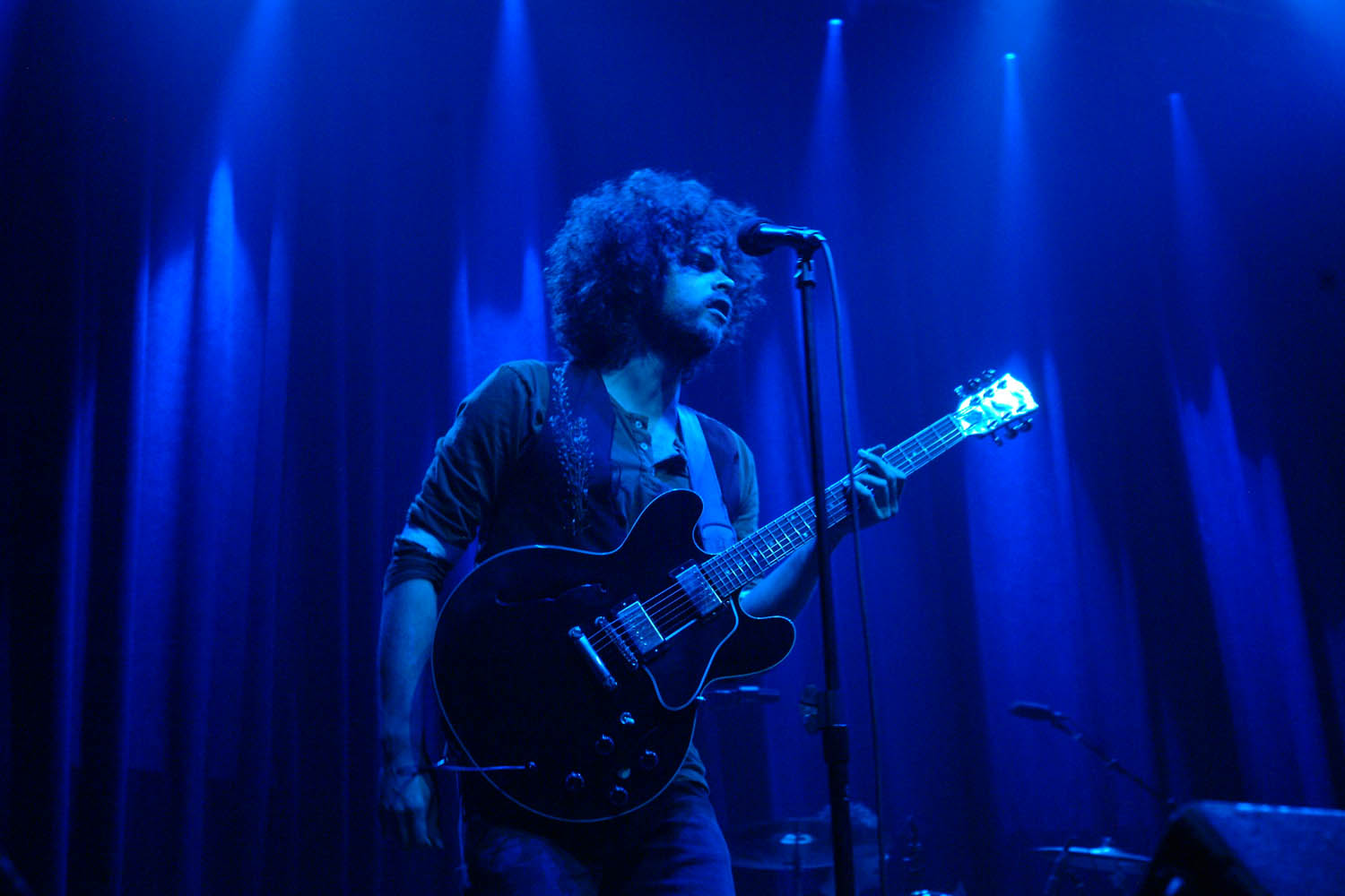 Andrew Stockdale of Wolfmother. A single colored light can affect your image and draw in the viewer. Photo by Leon Armour Jr./Visual Stimuli Studios