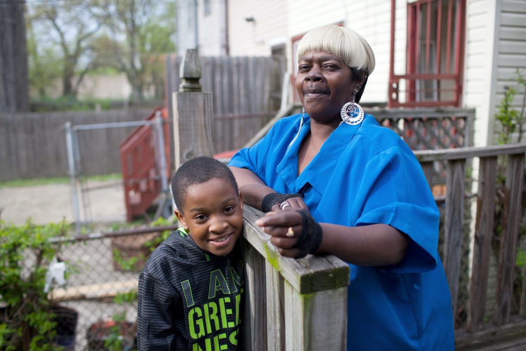 Treshawn Jones plays in his backyard while his aunt, Ora Jackson, supervises. Treshawn was born with fetal alcohol spectrum disorder and has had difficulty controlling his temper and following directions. Photo by James Bernal for STAT