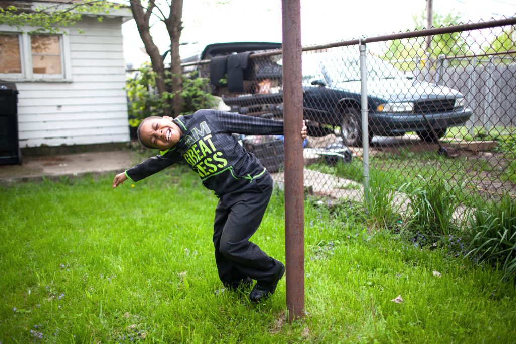 Treshawn Jones plays in his backyard on the South Side of Chicago. Photo by James Bernal for STAT
