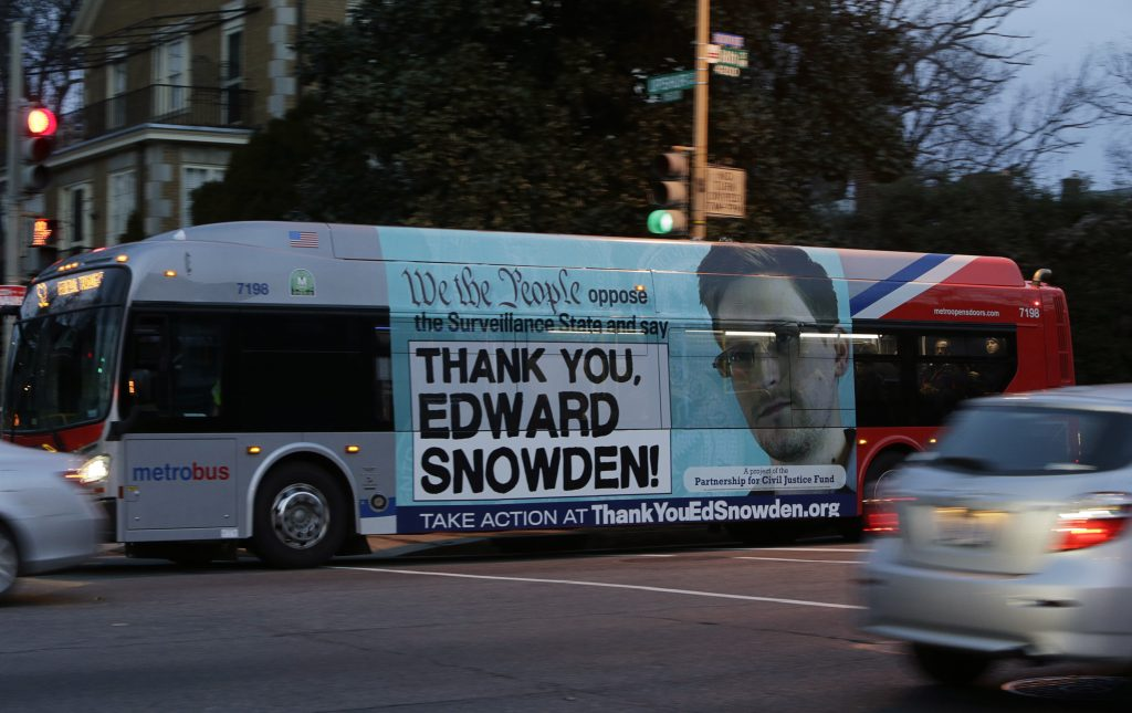 A Washington Metro bus is seen with an Edward Snowden sign on its side panel December 20, 2013. Photo by Gary Cameron/REUTERS