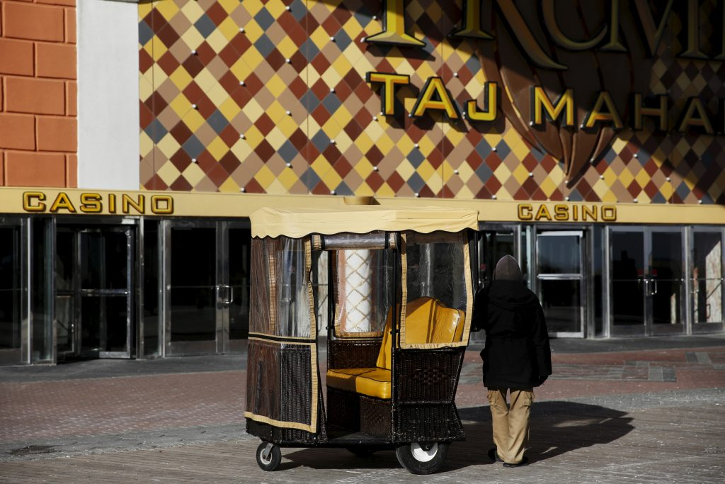 A pedicab driver waits for riders outside the Trump Taj Mahal Casino in Atlantic City, New Jersey. Photo by Shannon Stapleton/Reuters