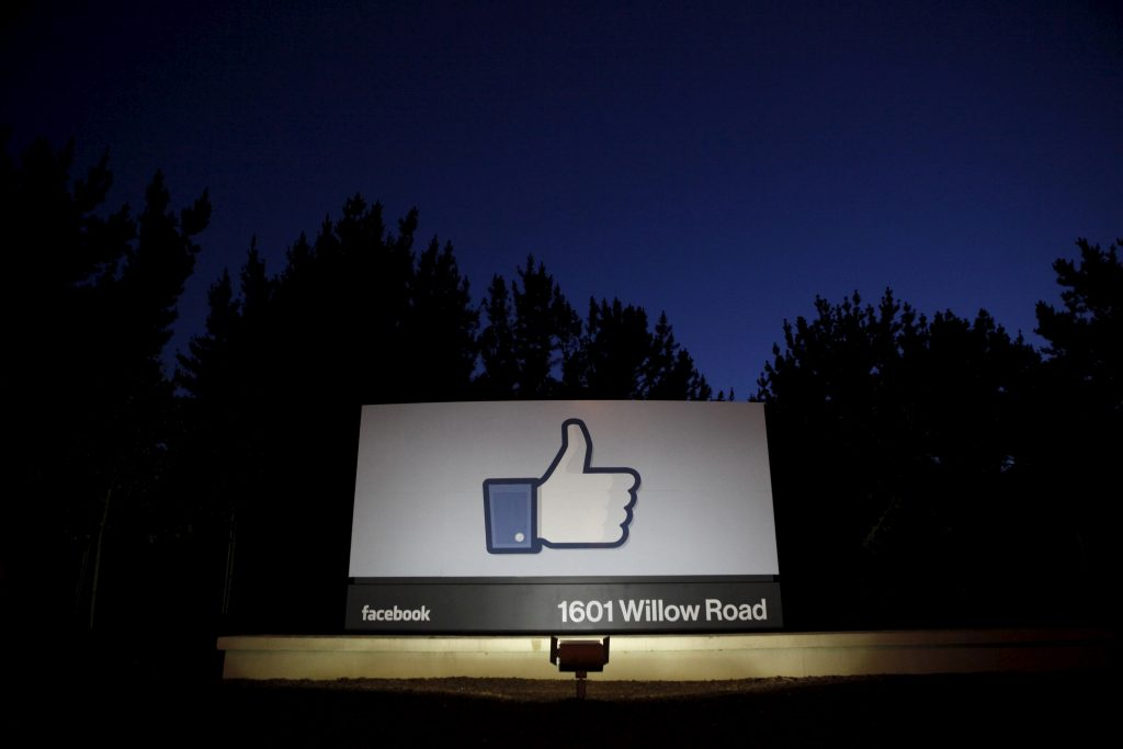 The sun rises behind the entrance sign to Facebook headquarters in Menlo Park before the company's IPO launch in 2012. Photo by Beck Diefenbach/Reuters