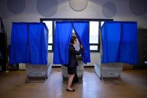 A voter leaves the booth after casting her ballot in the Pennsylvania primary at a polling place in Philadelphia