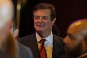 Paul Manafort, senior adviser to Republican presidential candidate Donald Trump, smiles as he talks with other Trump campaign staff on May 3. Photo By Lucas Jackson/Reuters