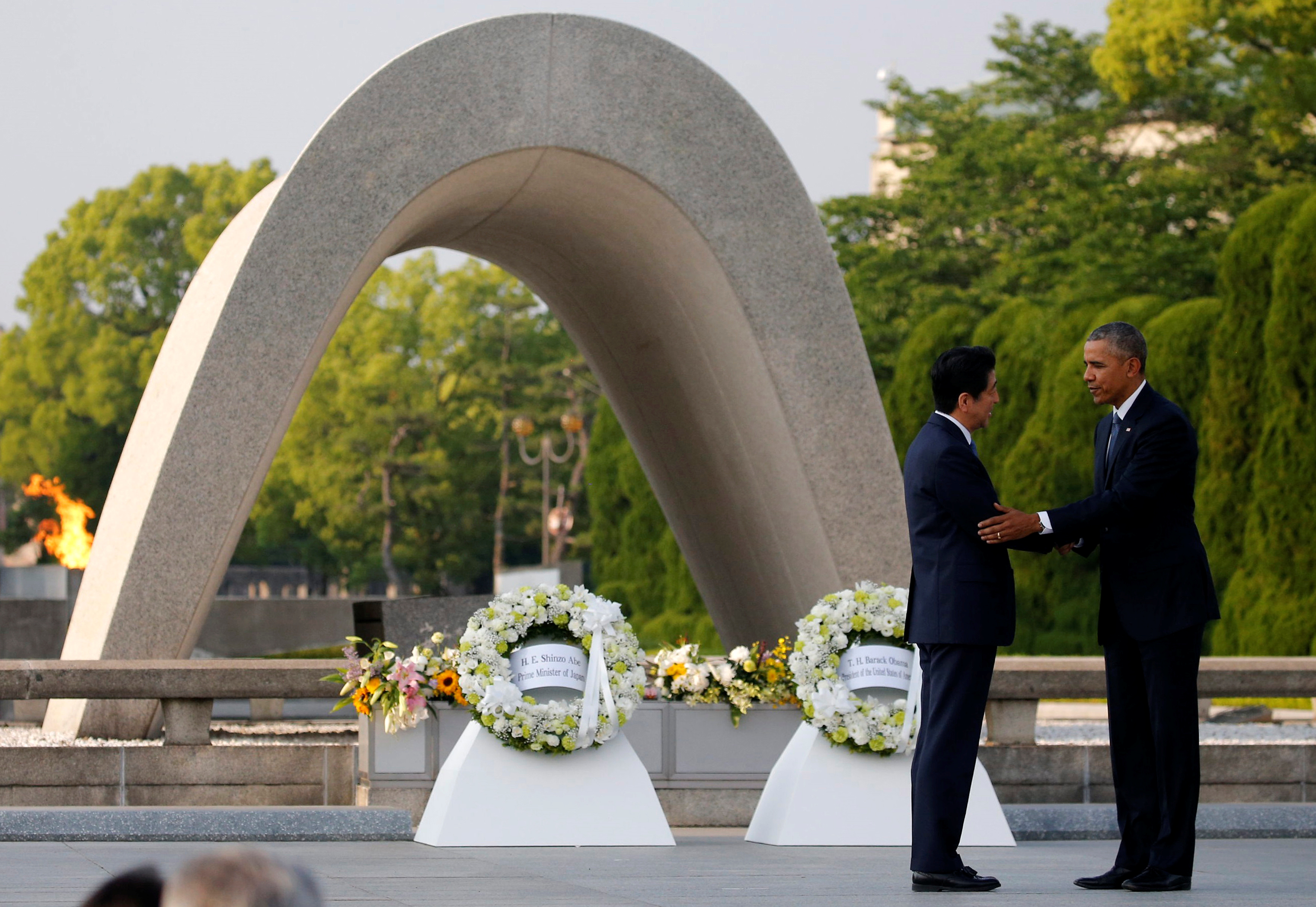 U.S. President Barack Obama puts his arm around Japanese Prime Minister Shinzo Abe after they laid wreaths in front of a cenotaph at Hiroshima Peace Memorial Park in Hiroshima, Japan on Friday. Photo by REUTERS/Carlos Barria
