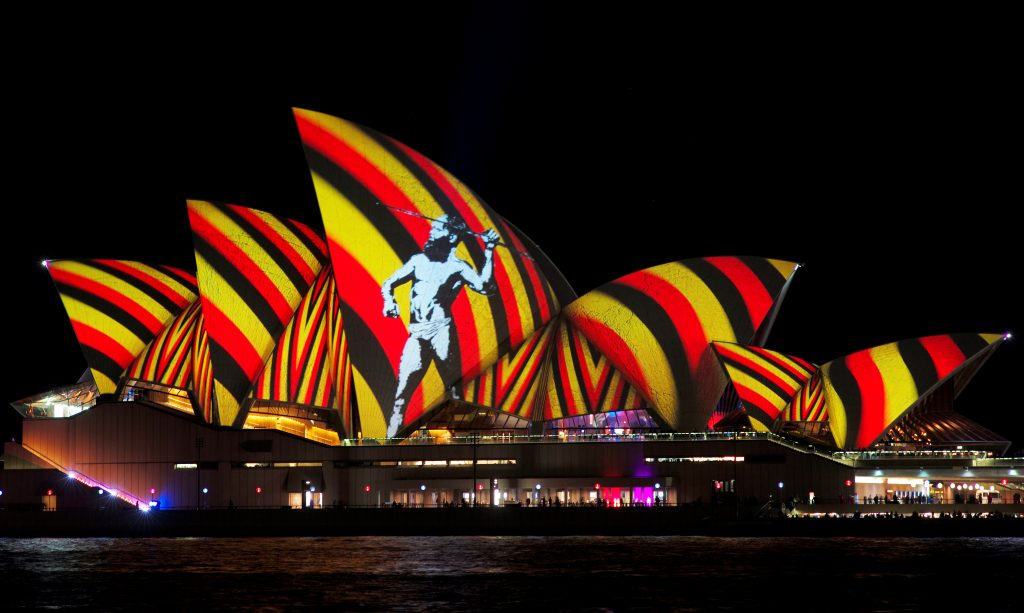 An Image Of Indigenous Australian Man Is Projected Onto The Sails Sydney Opera