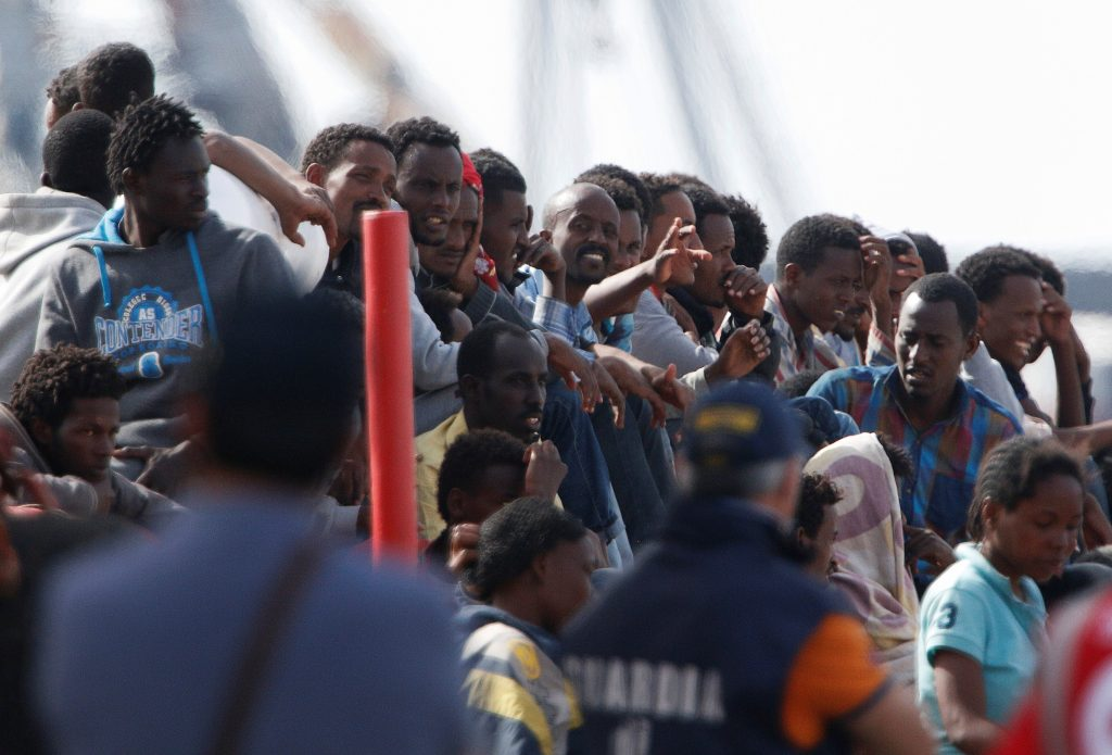 More than 14,000 people have been rescued attempting to cross the Mediterranean Sea during this last week. Shown here migrants leaving a rescue ship. Italy, May 28, 2016. Antonio Parrinello/Reuters