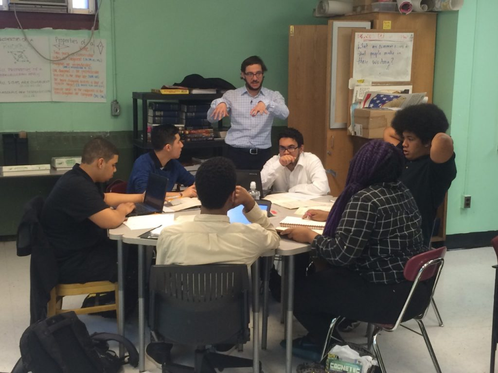 "New York City teacher Paul Zuppello talks to his A.P. History students about their plans to perform before the Broadway sensation ""Hamilton."" The shows producers have collaborated to allow 20,000 New York City students to see the production, while wrapping the lessons of Alexander Hamilton into respective curriculums. Photo By Michael D. Regan/PBS NewsHour"
