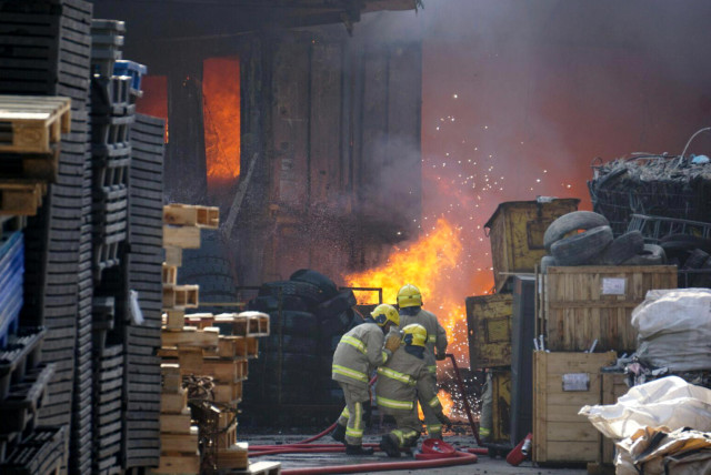Several fires have broken out at junkyards in the past year, including two incidents in March that emitted plumes of toxic black smoke, according to local news reports. Courtesy of Cheung Choi