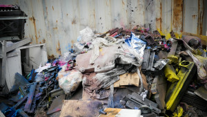 A pile of printer parts dusted with toners like carbon black, a possible carcinogen known to cause respiratory problems. Photo by Katie Campbell, KCTS9/EarthFix