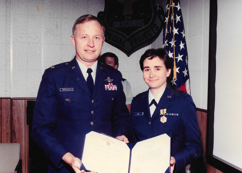 Laura Elliott receiving an Air Force Commendation Medal in 1990.