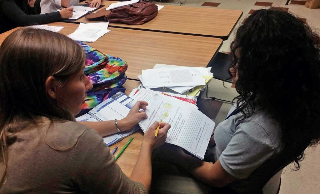 A volunteer mentor provides homework help at the Bakker Career Center, one of the facilities available under the Carolina Youth Development Center in Charleston, S.C. Photo courtesy of CYDC