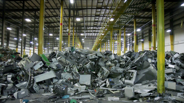 Plastics and metals from dismantled electronics await their turn to enter a machine that shreds and sorts them into commodity type. Photo by Ken Christensen, KCTS9/EarthFix