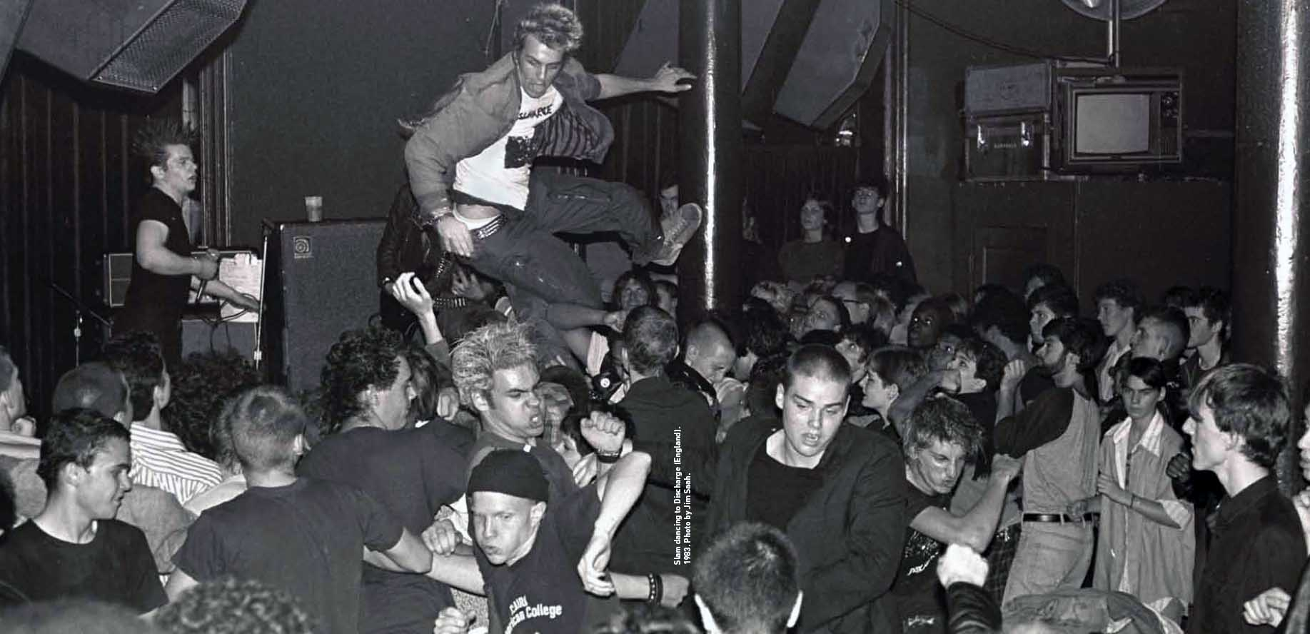 The crowd slam-dances to Discharge in 1983 at the old 9:30 Club. Photo by Jim Saah