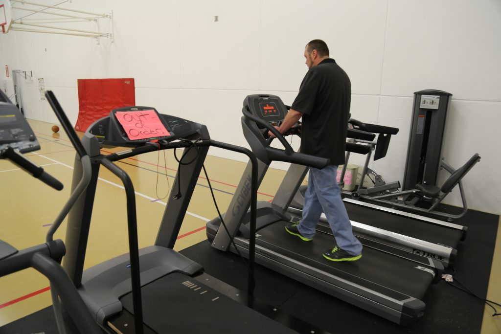 Brad Foster, a client in Minnesota's Sex Offender Program, works out on the treadmill. Photo by Mike Fritz