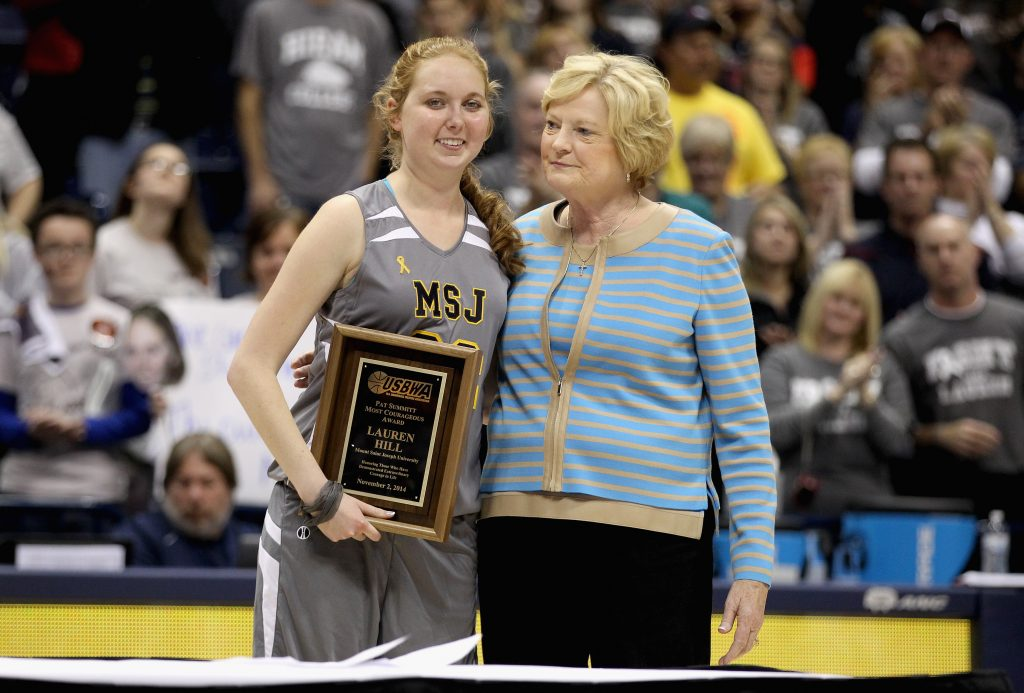 Lauren Hill of Mount St. Joseph shares a hug with Pat Summitt during a halftime awards ceremony during the game against Hiram at Cintas Center on November 2, 2014 in Cincinnati, Ohio. Hill, a freshman, has terminal cancer and this game was granted a special waiver by the NCAA to start the season early so she could play in a game. Photo by Andy Lyons/Getty Images