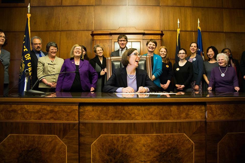 Oregon Governor Kate Brown signed the state's motor voter registration bill into law on January 1. The new law automatically registers a person to vote based on information they submitted to receive a driver's license, such as their age and citizenship status. Photo courtesy of Nikki Fisher/Bus Project