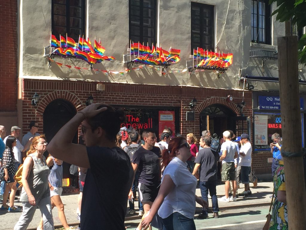 People gather outside the Stonewall Inn in New York City on June 12, 2016. Photo by Omar Etman/PBS NewsHour