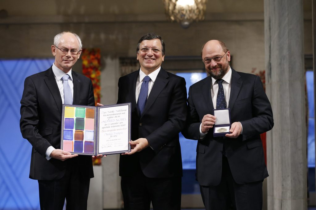 (From L - R) European Council President Herman Van Rompuy, European Commission President Jose Manuel Barroso, and European Parliament President Martin Schulz are pictured with the Nobel diploma during the Nobel Peace Prize ceremony in Oslo City Hall, Oslo December 10, 2012. The European Union received the Nobel Peace Prize on Monday, an award which some past winners called unjustified but European leaders defended for recognising the stability and democracy brought to the continent after two world wars. Picture taken December 10, 2012. REUTERS/Cornelius Poppe/NTB scanpix /pool (NORWAY - Tags: POLITICS) THIS IMAGE HAS BEEN SUPPLIED BY A THIRD PARTY. IT IS DISTRIBUTED, EXACTLY AS RECEIVED BY REUTERS, AS A SERVICE TO CLIENTS. NORWAY OUT. NO COMMERCIAL OR EDITORIAL SALES IN NORWAY. NO COMMERCIAL SALES - RTR3BHY7