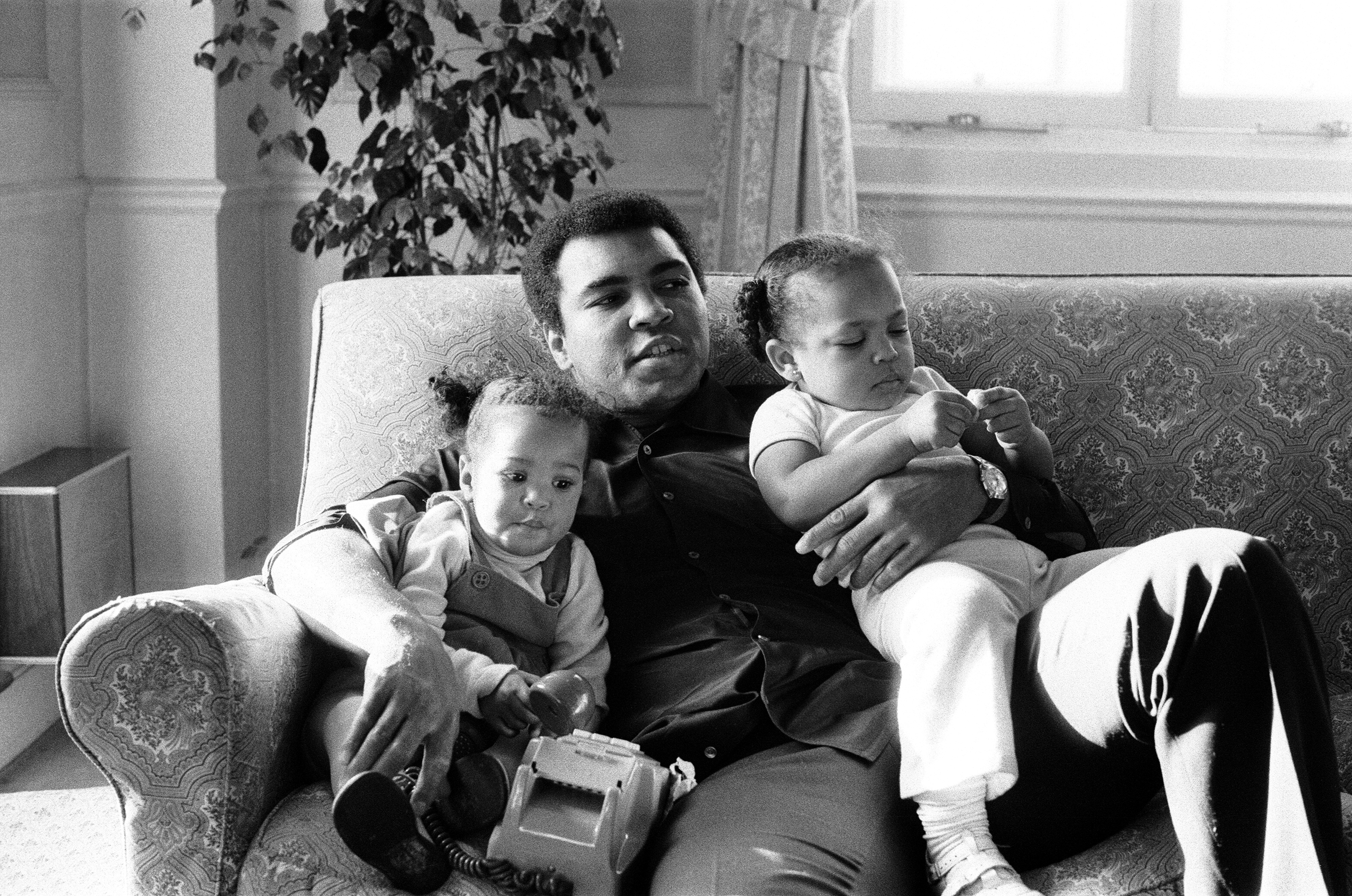Muhammad Ali cuddles his daughters Laila (left) and Hana at a hotel in London on Dec. 19, 1978. File photo by Action Images/MSI via Reuters