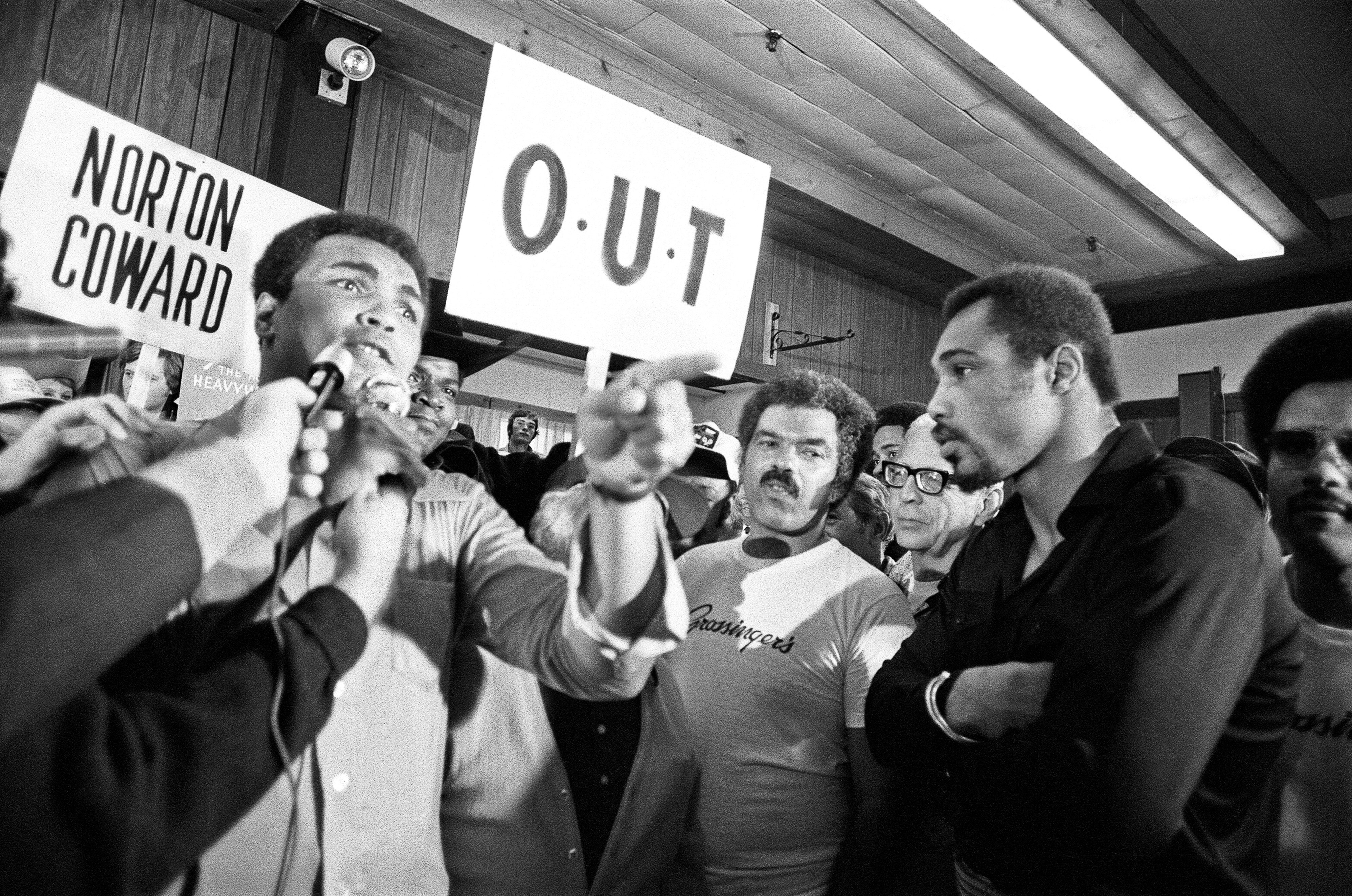 Muhammad Ali and his entourage taunt Ken Norton ahead of their third fight in New York on Sept. 23, 1976. File photo by Action Images/MSI via Reuters