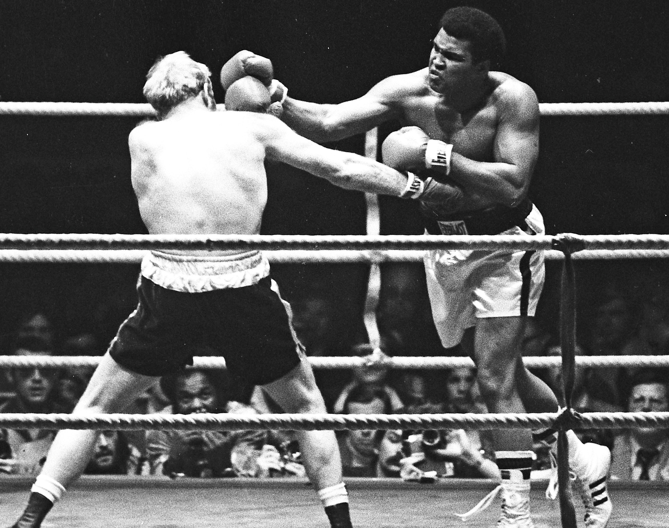 Muhammad Ali (left) punches Richard Dunn for the heavyweight title in Munich, Germany on May 24, 1976. File photo by Action Images/Sporting Pictures via Reuters