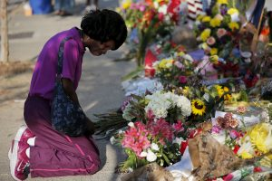 Patricia Bailey prays at a makeshift memorial outside the Emanuel African Methodist Episcopal Church in Charleston
