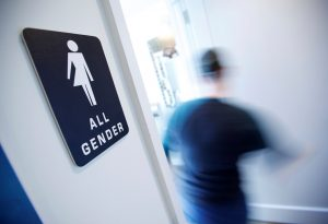 "A bathroom sign welcomes both genders at the Cacao Cinnamon coffee shop in Durham, North Carolina May 3, 2016. The shop installed the signs after North Carolina's ""bathroom law"" gained national attention, positioning the state at the center of a debate over equality, privacy and religious freedom.   REUTERS/Jonathan Drake        - RTX2CPEL"