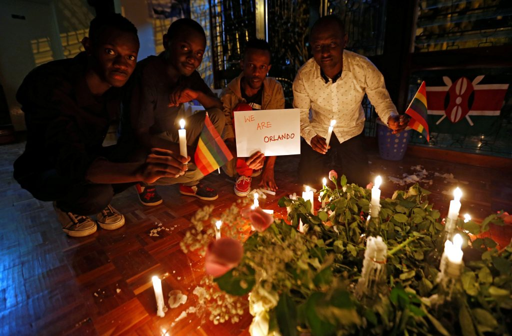 People light candles to pay tribute to the victims of the mass shooting at the Pulse gay nightclub in Orlando, U.S., in Kenya's capital Nairobi. Photo by Thomas Mukoya/Reuters