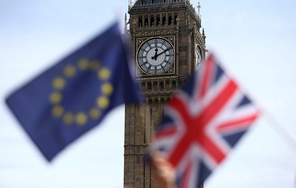 Participants hold a British Union flag and an EU flag during a pro-EU referendum event at Parliament Square in London, Britain June 19, 2016. Photo by Neil Hall/Reuters