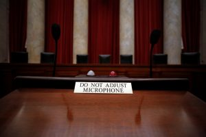 A notice is seen on a lectern, which faces the bench and where lawyers stand to argue, in the courtroom of the U.S. Supreme Court in Washington, D.C. Photo by Jonathan Ernst/Reuters