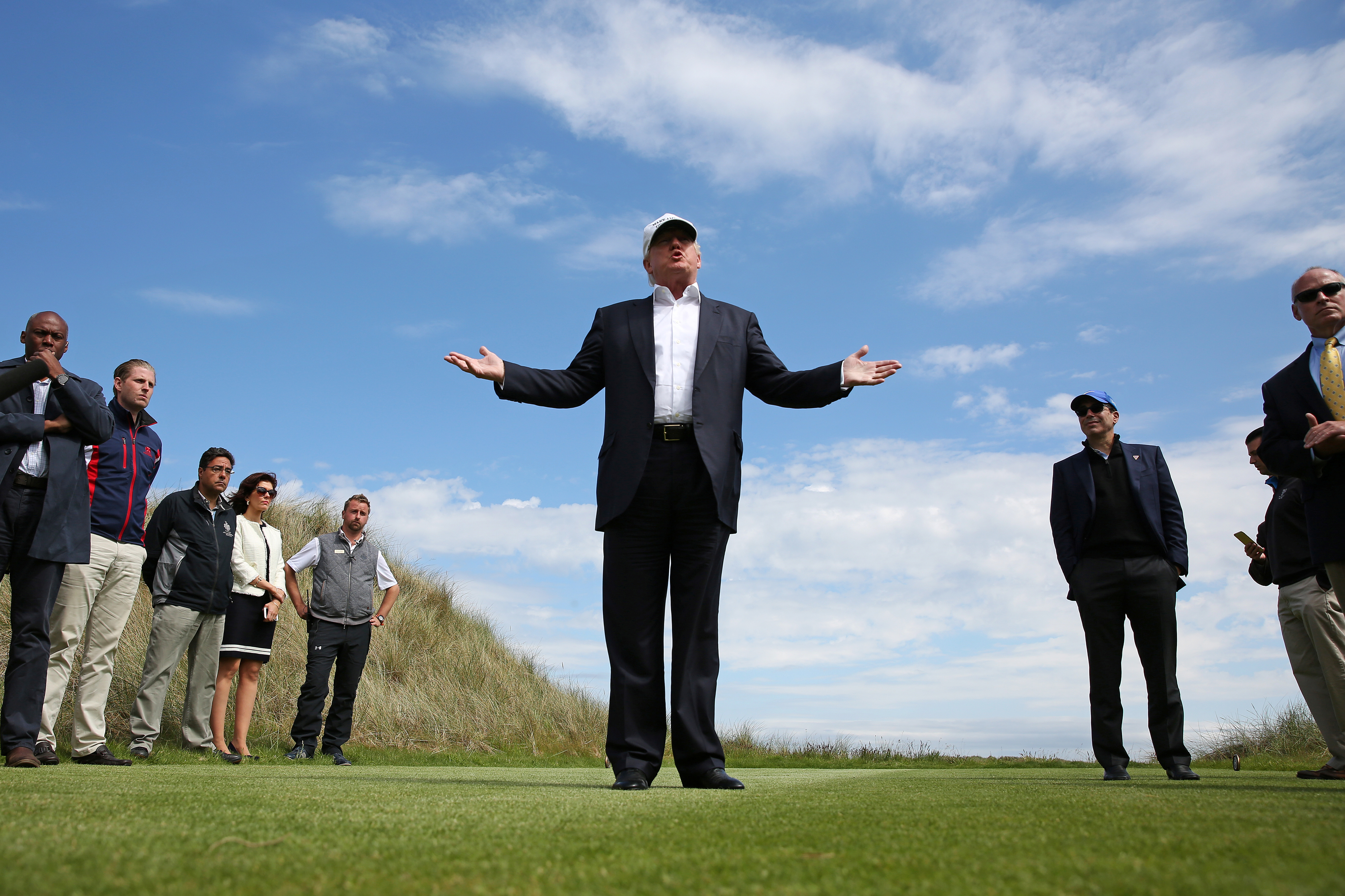 Republican presidential candidate Donald Trump speaks to the media on the golf course at his Trump International Golf Links in Aberdeen, Scotland, June 25, 2016.  REUTERS/Carlo Allegri.     TPX IMAGES OF THE DAY      - RTX2I63W