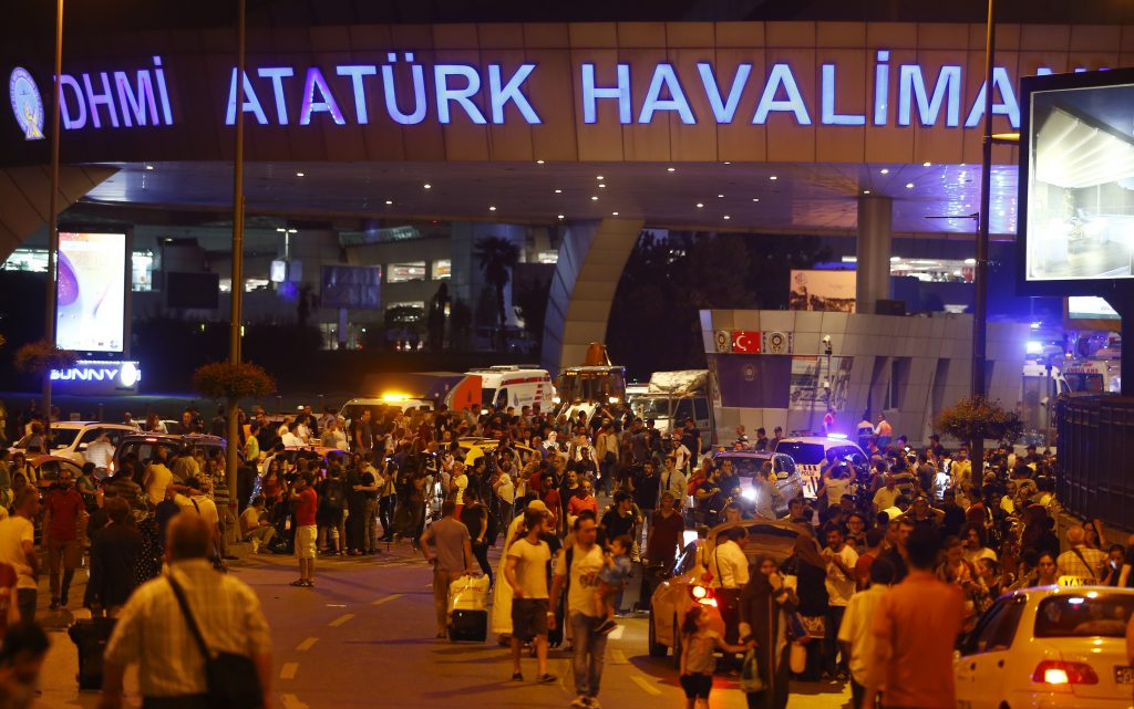 People leave Turkey's largest airport, Istanbul Atatürk, Turkey, following a blast June 28, 2016. REUTERS/Osman Orsal